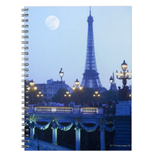 Eiffel tower at dusk with moonrise spiral note book