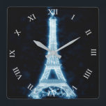 """Eiffel Tower in White Neon Glow Square Wall Clock<br><div class=""""desc"""">Eiffel Tower in a white neon glow artwork. Gives off an electrifying look with the dark background. Roman number clock face. If making changes, be sure the number image is on top. Change the square clock for round clock styles. CONTACT sandyswebnetwork@gmail.com about image design &amp; products with this design. I...</div>"""