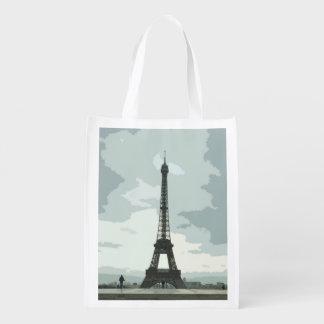 Eiffel Tower under Cloudy Skies Grocery Bag