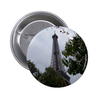 Eiffel Tower view between foliage Pins