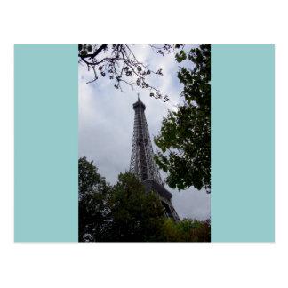 Eiffel Tower view between foliage Postcard