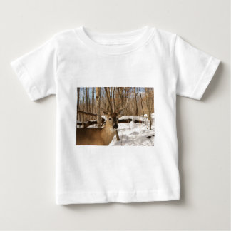 Eight point buck in winter snow. baby T-Shirt