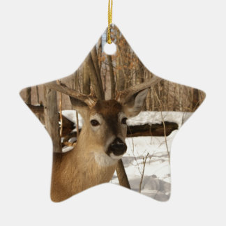 Eight point buck in winter snow. ceramic ornament