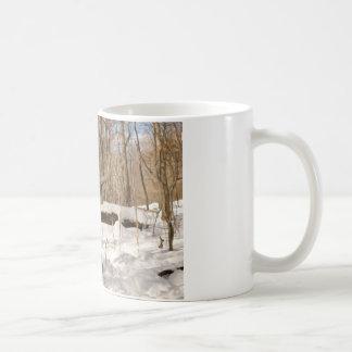 Eight point buck in winter snow. mug