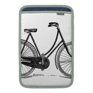 Ejemplo antiguo de la silueta de la bicicleta del  fundas para macbook air