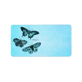Ejemplo azul de la mariposa del trullo del vintage etiquetas de dirección