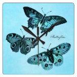 Ejemplo azul de la mariposa del trullo del vintage reloj de pared