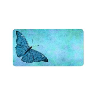 Ejemplo azul de los 1800s de la mariposa del etiquetas de dirección