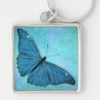 Ejemplo azul de los 1800s de la mariposa del llavero cuadrado plateado