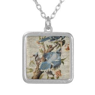 Ejemplo azul del vintage de los pájaros en la colgante cuadrado