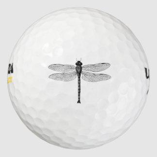 Ejemplo blanco y negro de la libélula del vintage pack de pelotas de golf