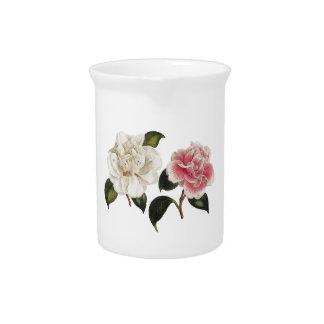 Ejemplo color de rosa blanco y rosado jarras para bebida