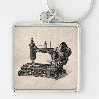 Ejemplo de la máquina de coser de los 1800s del llavero cuadrado plateado