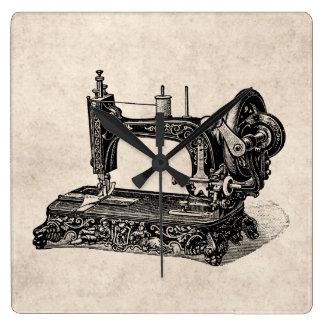 Ejemplo de la máquina de coser de los 1800s del vi reloj cuadrado