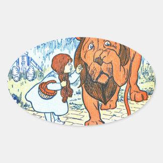 Ejemplo de mago de Oz del vintage - Dorothy y león Calcomanía Oval Personalizadas