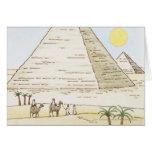 Ejemplo de pirámides y de hombres con los camellos felicitación