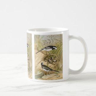 Ejemplo de varios colores del pájaro del vintage taza de café