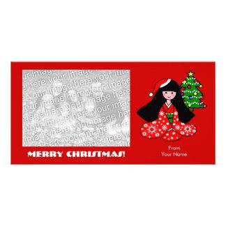 Ejemplo del dibujo animado del navidad del chica d tarjetas personales con fotos