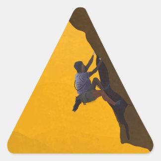 Ejemplo del escalador de roca de la subida de la pegatina triangular