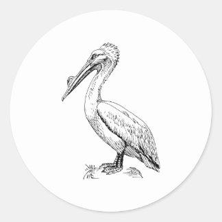 Ejemplo del pájaro del pelícano etiquetas redondas