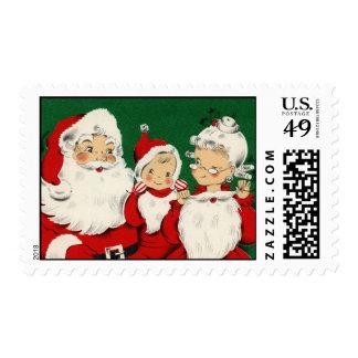 Ejemplo del vintage de la familia de Santa Sellos Postales