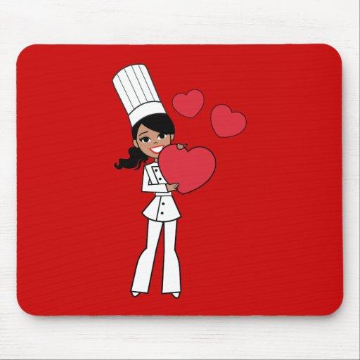 Ejemplo lindo del chica del cocinero del panadero tapetes de ratón