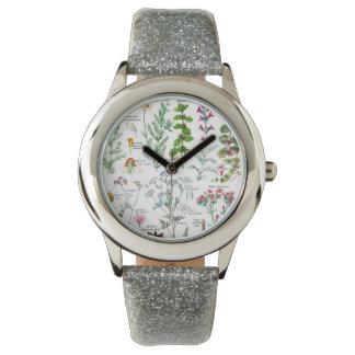 Ejemplos botánicos - plantas de Larousse Reloj