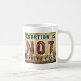 El aborto no es atención sanitaria tazas