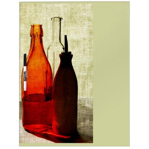 el aceite de oliva embotella al tablero seco del b pizarras