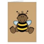 El afroamericano manosea al bebé de la abeja felicitacion