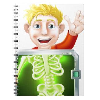 El agitar del hombre de la radiografía libro de apuntes con espiral
