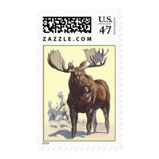 El alce que vadea en el día de invierno soleado timbres postales