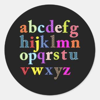 El alfabeto pegatina redonda