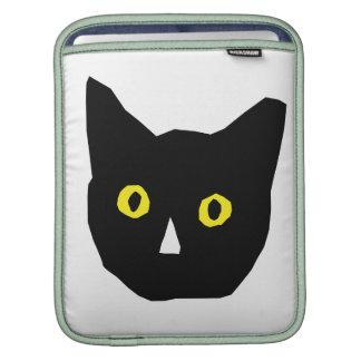 el amarillo negro principal del gato observa el di mangas de iPad