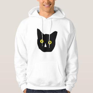 el amarillo negro principal del gato observa el pulóver