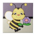 El amarillo retro manosea la abeja azulejo cerámica