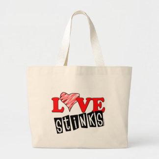 El amor apesta los regalos bolsa tela grande