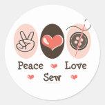 El amor de la paz cose a los pegatinas de costura
