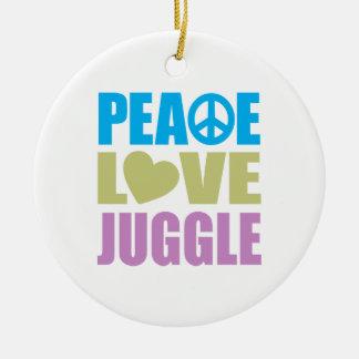 El amor de la paz hace juegos malabares adorno redondo de cerámica