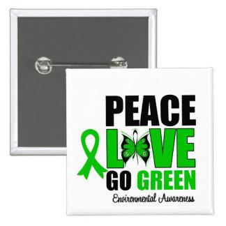El amor de la paz va mariposa verde del ambiente pins