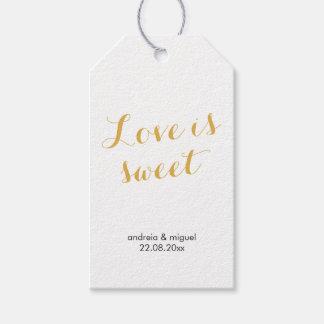 El amor es negro dulce del oro de la escritura de etiquetas para regalos