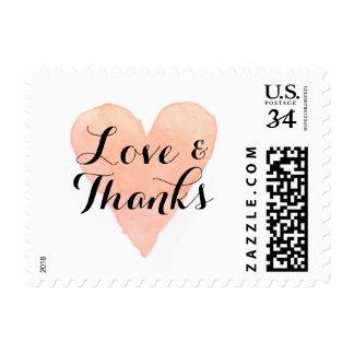 El amor rosado coralino del corazón de la acuarela timbre postal