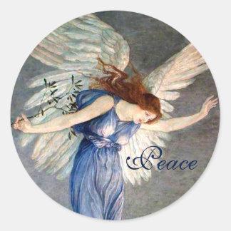 El ángel de la grúa del navidad de la paz pegatina redonda