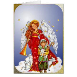 El ángel del navidad y el pequeño muchacho del tarjeta de felicitación