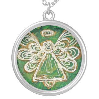 El ángel verde se va volando el colgante de plata