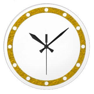 El anillo de la cara de reloj puntea el oro para s