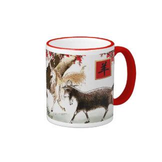 El año chino de la cabra/del regalo del espolón taza de dos colores