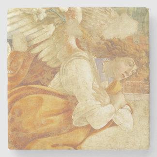 El anuncio, detalle del arcángel posavasos de piedra