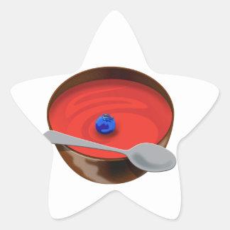 El arándano en un cuenco de sopa del tomate - calcomanías forma de estrellaes
