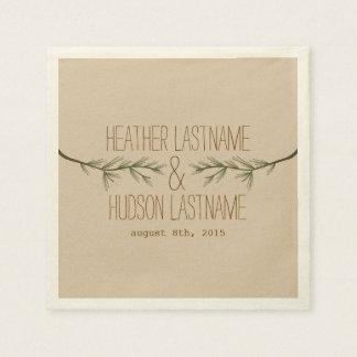 El árbol de hoja perenne ramifica las servilletas servilleta de papel